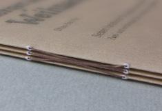 Besondere Bindetechnik für Broschüren